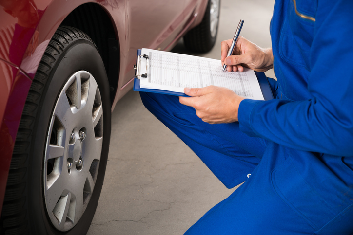 Mechanic Examining Car Wheel